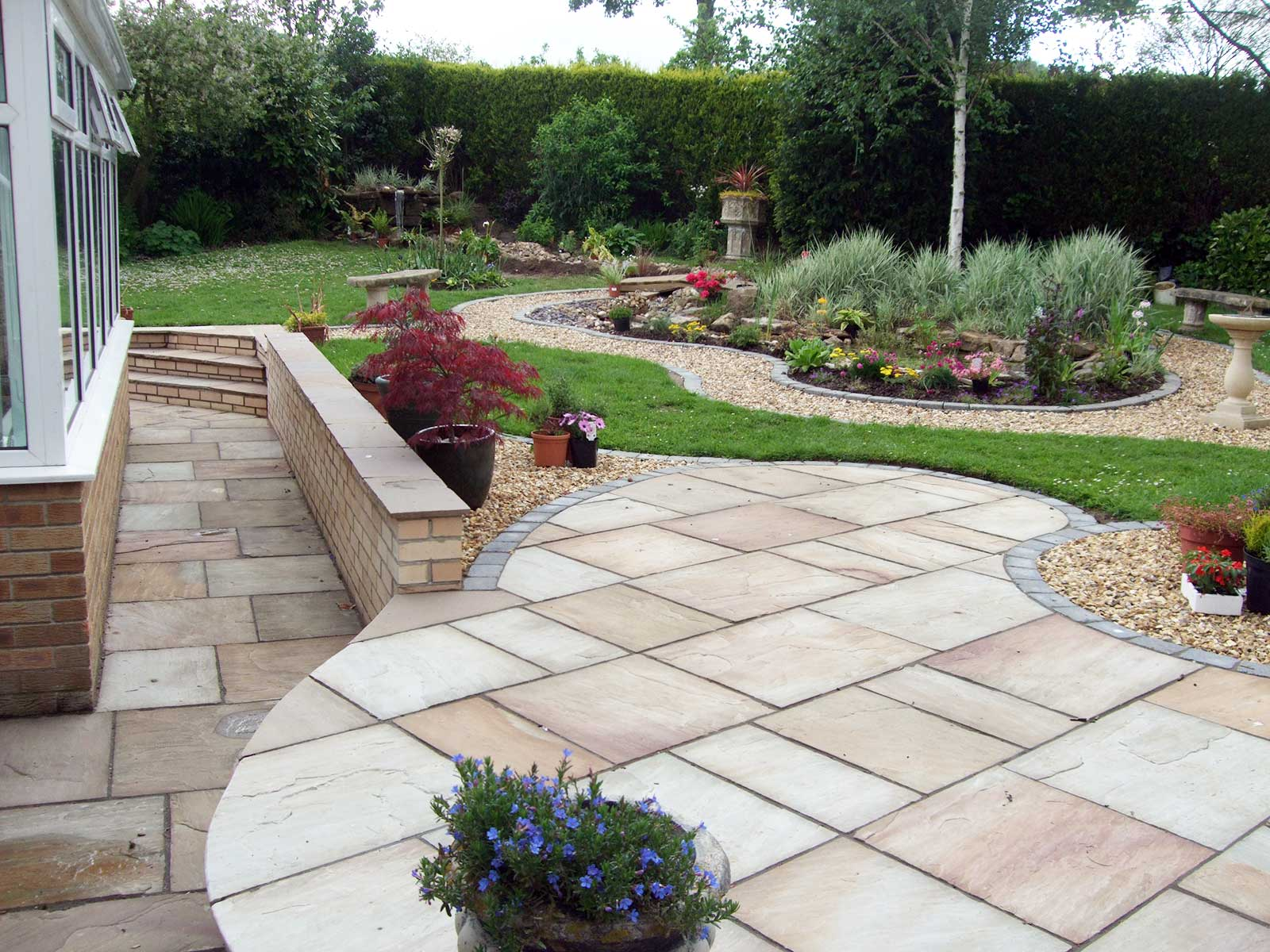 CREATIVE PATIO AND LANDSCAPE DESIGN. Patios